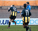 Montrose's Jonathan Crawford catches Berwick's Scott Dalziel with high boot as he head towards an open goal and earns himself a straight red.