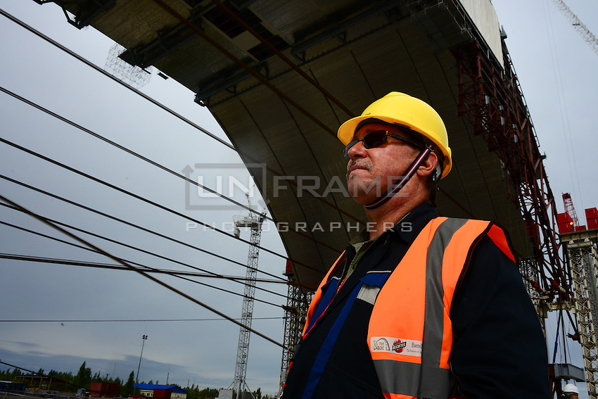 Don Kelly. CIH. Health and Safety Engineer, seen in front of the Eastern part of the Arch - New Safe Confinement for 4th reactor of Chernobyl Power Plant, to prevent the reactor complex from leaking radioactive material into the environment.