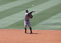 25th July 2020, Los Angeles, California, USA;  San Francisco Giants infielder Mauricio Dubon (1) makes a throw to first base during the game against the Los Angeles Dodgers on July 25, 2020, at Dodger Stadium in Los Angeles, CA.