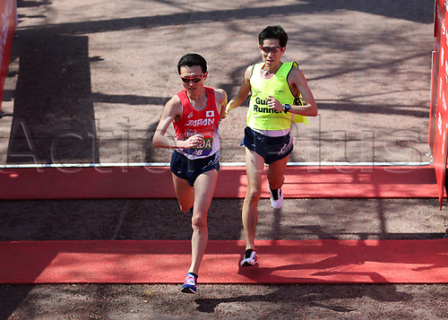 22nd April 2018, London, England; The 2018 Virgin London Marathon; Shinya Wada of Japan with his Guide Runner crosses the finishing line in the T11/12 Men race