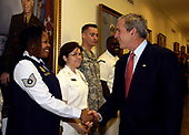 Arlington, VA - May 10, 2007 -- United States President George W. Bush shakes hands with U.S. Air Force Technical Sergeant Nakisha Turner-Brown after a meeting in the Pentagon with Secretary of Defense Robert M. Gates, Chairman of the Joint Chiefs of Staff General Peter Pace, United States Marine Corps, the Joint Chiefs and other senior defense officials on Thursday, May 10, 2007.  The president met and thanked service members for their service to their country.  Bush was in the Pentagon to receive briefings from the senior defense leadership on military operations around the world. <br /> Credit: D. Myles Cullen - DoD via CNP