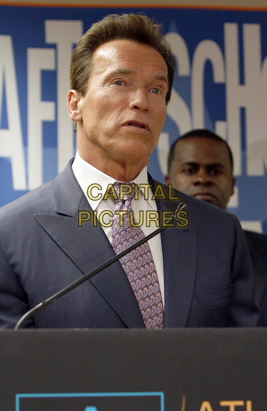 ARNOLD SCHWARZENEGGER.California Governor and actor Arnold Schwarzenegger, National Honorary Chairman of the After-School All-Stars program, attended the After-School Atll-Stars Atlanta Assembly Atlanta Assembly at the Joseph Emerson Brown Middle School, Atlanta, GA, USA..May 10th, 2010.headshot portrait grey gray suit pink tie podium speech microphone .CAP/ADM/DH.©Dan Harr/AdMedia/Capital Pictures.