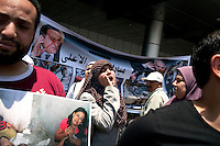 Egypt / Cairo / 11.6.2012 / Sarah, Sister Rhada's daughter, protests against the former Prime Minister of Mubarak, Ahmed Shafik, who was at that moment in the run-off against Mohammad Morsi for the Presidency. The demonstration was in front of the Cairo airport, a project headed by Ahmed Shafik that is the currently at the the centre of much controversy. Cairo, Egypt. June 11th, 2012.<br /> <br /> © Giulia Marchi