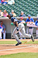 Mississippi Braves left fielder Travis Demeritte (18) runs to first base during a game against the Tennessee Smokies at Smokies Stadium on May 20, 2018 in Kodak, Tennessee. The Braves defeated the Smokies 7-4. (Tony Farlow/Four Seam Images)