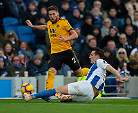 Wolverhampton Wanderers' Matt Doherty (left) is tackled by Brighton &amp; Hove Albion's Lewis Dunk (right) <br /> <br /> Photographer David Horton/CameraSport<br /> <br /> The Premier League - Brighton and Hove Albion v Wolverhampton Wanderers - Saturday 27th October 2018 - The Amex Stadium - Brighton<br /> <br /> World Copyright &copy; 2018 CameraSport. All rights reserved. 43 Linden Ave. Countesthorpe. Leicester. England. LE8 5PG - Tel: +44 (0) 116 277 4147 - admin@camerasport.com - www.camerasport.com