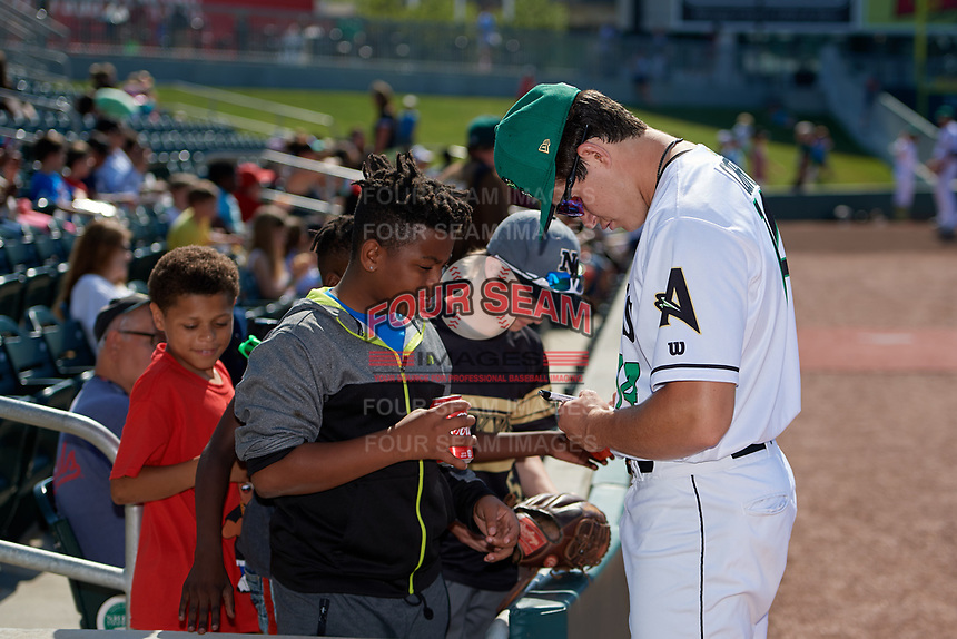 Augusta GreenJackets pitcher Seth Corry (14) signs autographs before a South Atlantic League game against the Lexington Legends on April 30, 2019 at SRP Park in Augusta, Georgia.  Augusta defeated Lexington 5-1.  (Mike Janes/Four Seam Images)