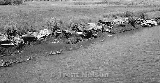 Abandoned cars set along the banks of the Duchesne River.<br />