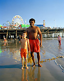 USA; Brown Cannon; Santa Monica; Santa Monica State Beach; Beach; Santa Monica Pier; Summer; Summertime; Weekend; Travel; Clear Sky; Smile, Father, Son, Father And Son; Outdoors; Healthy; Sunshine; Blue; Sky; Vacation; Weekend Activity, Beach Town, Swimmers, Portrait