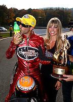 Oct 6, 2013; Mohnton, PA, USA; NHRA pro stock motorcycle rider Matt Smith celebrates after winning the Auto Plus Nationals at Maple Grove Raceway. Mandatory Credit: Mark J. Rebilas-