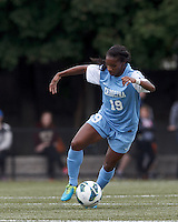 University of North Carolina midfielder Crystal Dunn (19) controls the ball.  University of North Carolina (blue) defeated Boston College (white), 1-0, at Newton Campus Field, on October 13, 2013.