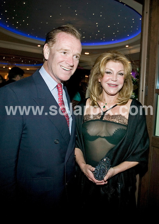 """**ALL ROUND PICTURES FROM SOLARPIX.COM**.**WORLDWIDE SYNDICATION RIGHTS**.Major James Hewitt entertains friends and associates at the opening of his new restaurant """"Polo House"""" in Marbella, Spain. 2 April 2009.This pic: Major James Hewitt and Baronessa Carmen Thyssen Bornemisza..JOB REF: 8764 MTN     DATE: 02_04_2009.**MUST CREDIT SOLARPIX.COM OR DOUBLE FEE WILL BE CHARGED**.**ONLINE USAGE FEE GBP 50.00 PER PICTURE - NOTIFICATION OF USAGE TO PHOTO @ SOLARPIX.COM**.**CALL SOLARPIX : +34 952 811 768 or LOW RATE FROM UK 0844 617 7637**"""