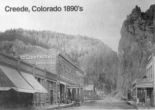 View of Creede Avenue business district.  Tomkins Bros. Hardware and Lightner &amp; Co. signs are in evidence.<br /> Creede, CO  ca. 1895-1899