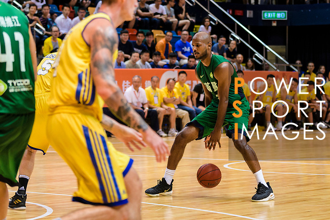 Austin Bryant M #23 of Tycoon Basketball Team handles the ball against the Winling during the Hong Kong Basketball League playoff game between Winling and Tycoon at Queen Elizabeth Stadium on July 24, 2018 in Hong Kong. Photo by Marcio Rodrigo Machado / Power Sport Images