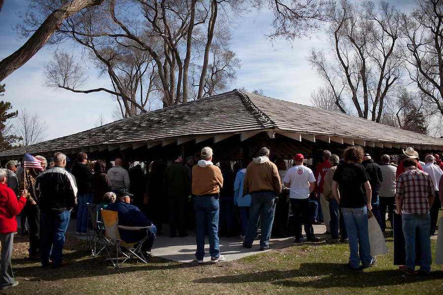 North Platte, Nebraska, April 1, 2010 - Tea Party supporters gather around the pavilion in Cody Park during a Tea Party Express rally. The tour which began in Searchlight, NV, hometown of Senate Majority Leader Harry Reid, will wind through the 43 cities across the United States ending up in Washington, D.C. on April 15 for a tax day rally..
