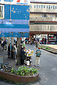 People buying food next to the Bazaar in Curepipe, Mauritius.