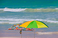 Colorful umbrellas on an O'ahu beach.