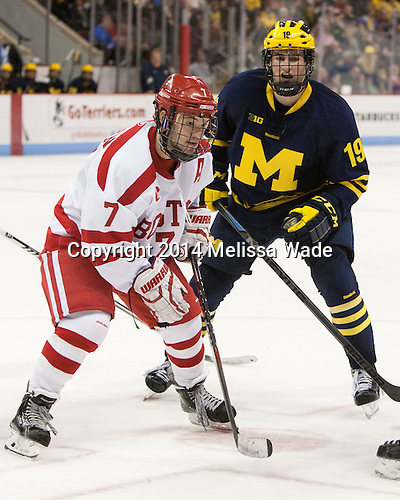 Cason Hohmann (BU - 7), Dylan Larkin (Michigan - 19) - The Boston University Terriers defeated the visiting University of Michigan Wolverines 3-2 on Saturday, October 25, 2014, at Agganis Arena in Boston, Massachusetts.
