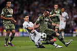James Rodriguez (l) of Real Madrid competes for the ball with Michal Kucharczyk of Legia Warszawa during the 2016-17 UEFA Champions League match between Real Madrid and Legia Warszawa at the Santiago Bernabeu Stadium on 18 October 2016 in Madrid, Spain. Photo by Diego Gonzalez Souto / Power Sport Images