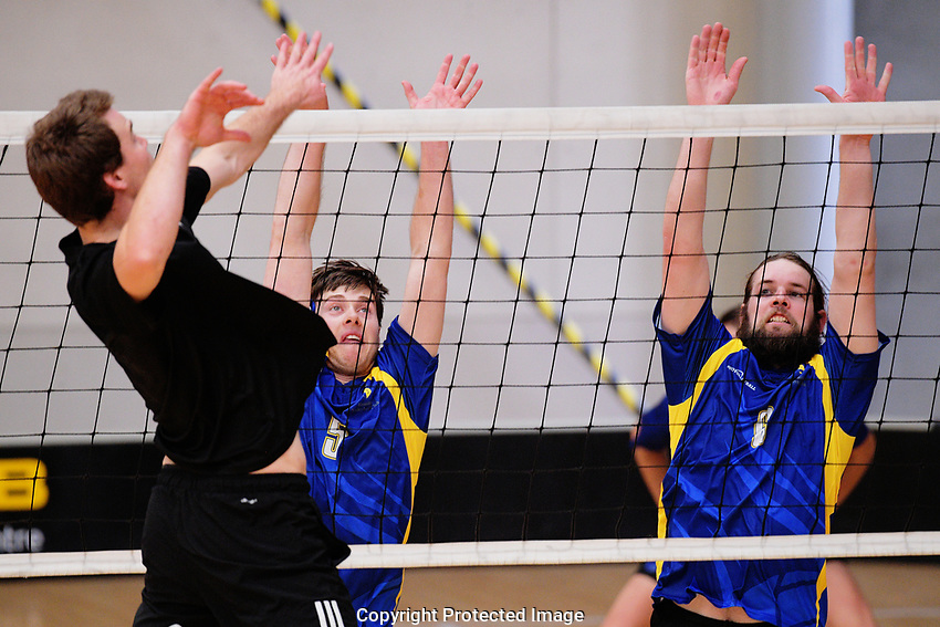 Action from the Volleyball NZ 50th National Club Championship men's division one match between the Harbour Raiders and Hamilton (blue and yellow) at ASB Sports Centre in Wellington, New Zealand on Saturday, 12 October 2017. Photo: Dave Lintott / lintottphoto.co.nz