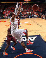 Virginia forward Akil Mitchell (25) dunks the ball during the game Tuesday in Charlottesville, VA. Virginia defeated Virginia Tech73-55.
