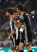 Calcio, Serie A: Lazio vs Juventus. Roma, stadio Olimpico, 27 agosto 2016.<br /> From left, Juventus&rsquo; Sami Khedira, Paulo Dybala and Gianluigi Buffon celebrate at the end of the Serie A soccer match between Lazio and Juventus, at Rome's Olympic stadium, 27 August 2016. Juventus won 1-0.<br /> UPDATE IMAGES PRESS/Isabella Bonotto