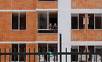 SOACHA, COLOMBIA - APRIL 30: Two womans stands in an aparment on an empty apartments complex on April 30, 2020 in Soacha. Around 300 people invaded an empty aparment complex to demand government attention during the Coronavirus pandemic that infected 6207 people and claimed 278 lives in the country. (Photo by Leonardo Munoz/VIEWpress via Getty Images)