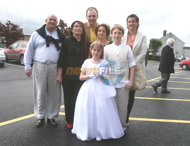 Ana, Cian, Ana, Antonio and Hugh Byrne and Suzanna Raquel at Marymount First Holy Communion in Ballsgrove Church...Photo NEWSFILE/Jenny Matthews.(Photo credit should read Jenny Matthews/NEWSFILE)....This Picture has been sent you under the condtions enclosed by:.Newsfile Ltd..The Studio,.Millmount Abbey,.Drogheda,.Co Meath..Ireland..Tel: +353(0)41-9871240.Fax: +353(0)41-9871260.GSM: +353(0)86-2500958.email: pictures@newsfile.ie.www.newsfile.ie.FTP: 193.120.102.198.