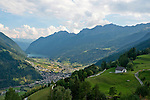 The Bernina Express climbs up from the Valposchiavo valley towards St Mortiz; it is the highest altitute transalpine railway and one of the steepest railways. This view is of the Valposchiavo valley towards Tirano Italy and a view of Miralago in the background