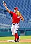 21 June 2011: Washington Nationals third baseman Ryan Zimmerman warms up prior to a game against the Seattle Mariners at Nationals Park in Washington, District of Columbia. The Nationals rallied from a 5-1 deficit, scoring 5 runs in the bottom of the 9th, to defeat the Mariners 6-5 in inter-league play. Mandatory Credit: Ed Wolfstein Photo