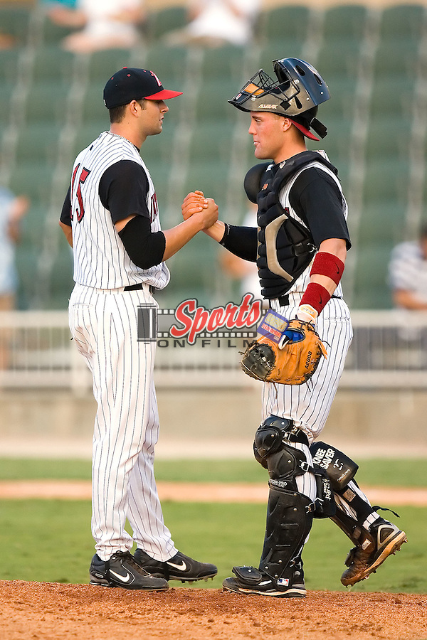 Michael Rocco (15) is congratulated by catcher Billy Killian (26) after nailing down the save as the Intimidators defeated the Hagerstown Suns 3-2 at Fieldcrest Cannon Stadium in Kannapolis, NC, Sunday, August 12, 2007.