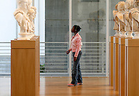 Sarah Cooper, 14, of Conyers, Ga., views sculptures during the pubic opening of Louvre Atlanta at the High Museum of Art. Over the next three years, the High Museum will feature hundreds of works of art from the Musée du Louvre in Paris.