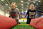 SIOUX FALLS, SD - JULY 2:  Campers Jackson Geerts, left, and Jon Rames practice explosion drills at the Riggs Football Academy Tuesday night at the Sanford Fieldhouse. (Photo by Dave Eggen/Inertia)