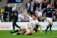 Ben Youngs of England offloads the ball after being tackled to ground. RBS Six Nations match between England and Scotland on March 11, 2017 at Twickenham Stadium in London, England. Photo by: Patrick Khachfe / Onside Images