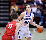 February 28, 2020; Yankton at St. Thomas More High School Basketball -- Connor Hollenbeck #20 of St. Thomas More looks past Yankton defender Cooper Cornemann #11 during their game Friday evening at Barnett Arena in Rapid City, S.D.(Photo by Richard Carlson/Inertia)