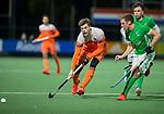 AMSTELVEEN - Lars Balk (Ned) met Jonathan Bell (IRE)   tijdens de hockeyinterland Nederland-Ierland (7-1) , naar aanloop van het WK hockey in India.  COPYRIGHT KOEN SUYK