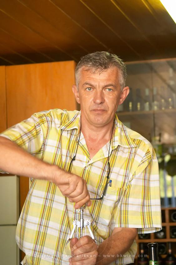 Tihomir Prusina, the oenologist. Opening a bottle of wine. Vinarija Citluk winery in Citluk near Mostar, part of Hercegovina Vino, Mostar. Federation Bosne i Hercegovine. Bosnia Herzegovina, Europe.