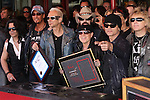 PAWEL MACIWODA, RUDOLF SCHENKER, LEMMY (Ian Fraser Kilmister), KLAUS MEINE, MATTHIAS JABS, JAMES KOTTAK. The Scorpions are inducted into Hollywood's RockWalk, dedicated to honoring artists who have made a significant impact on Rock 'n' Roll, Blues and R&B. Hollywood, CA, USA. April 6, 2010. .