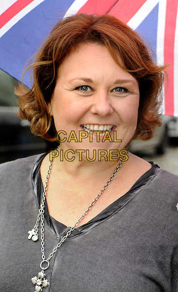 Wendi Peters.'Our House' Photocall outside the Cambridge Theatre, London to announce the 10th Anniversary West End gala concert at the Savoy Theatre in aid of Help for Heroes, London, England, October 19th 2012..portrait headshot grey gray smiling necklace .CAP/BK/PP.©Bob Kent/PP/Capital Pictures