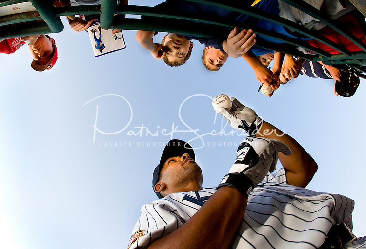 A Charlotte Knights baseball player signs autographs during a 2008 game.
