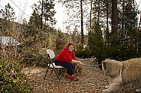 Emily Pearson in her front yard garden with Cody, the 3 year old female Akita.