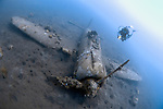 Wreck of a Mitsubishi Zero fighter plane with diver, Kimbe Bay