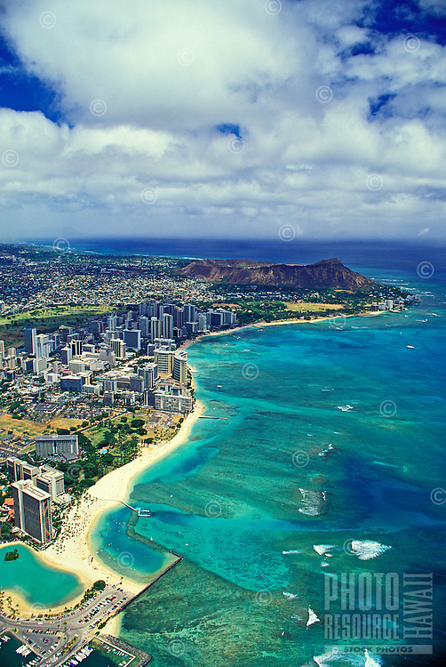 Great aerial shot of Waikiki hotels and beach and Diamond Head in the distance. Great contrast of white sand rimming the beautiful Pacific ocean.