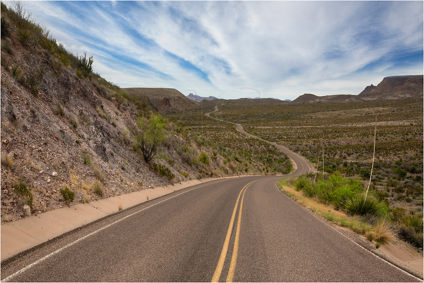 The drive between St. Elena Canyon and the Chisos Mountain Lodge is one of the more spectacular drives in the United States. Winding and curving around mountains and scenes that could come from the moon makes this road a fun adventure. This Big Bend National Park image comes from one of those twists.