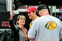 July 15, 2017 - Loudon, New Hampshire, U.S. - Joey Logano, Monster Energy NASCAR Cup Series driver of the Shell Pennzoil Ford (22), poses for a selfie with a fan before the NASCAR Monster Energy Overton's 301 practice round held at the New Hampshire Motor Speedway in Loudon, New Hampshire. Larson placed first in the qualifier. Eric Canha/CSM