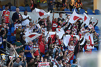 Japan supporters in the crowd celebrate their team's victory. Rugby World Cup Pool B match between South Africa and Japan on September 19, 2015 at the Brighton Community Stadium in Brighton, England. Photo by: Patrick Khachfe / Onside Images