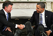 United States President Barack Obama (R) and President Juan Manuel Santos of Columbia shake hands during their meeting April 7, 2011 in the Oval Office of the White House in Washington, DC. Both presidents were expected to approve the recently agreed-upon Action Plan Related to Labor Rights and to discuss next steps with regard to the U.S.-Colombia Trade Promotion Agreement, according the a White House news release. .Credit: Alex Wong / Pool via CNP.Credit: Alex Wong / Pool via CNP