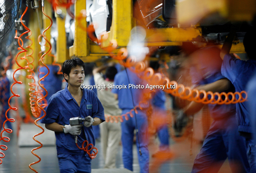Workers at the Geely automobile factory work on the assembly line at the company's site in Ningbo, China. Geely's profit rose 88 percent in 2006 as it sold more mid-range cars..