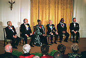 1999 Kennedy Center Honorees Victor Borge, Sean Connery, Judith Jamison, Jason Robards and Stevie Wonder sit with United States President Bill Clinton at a White House reception in their honor hosted by the President and first lady Hillary Rodham Clinton (not pictured) in Washington, D.C. on December 5, 1999..Credit: Robert Trippett-Pool / CNP