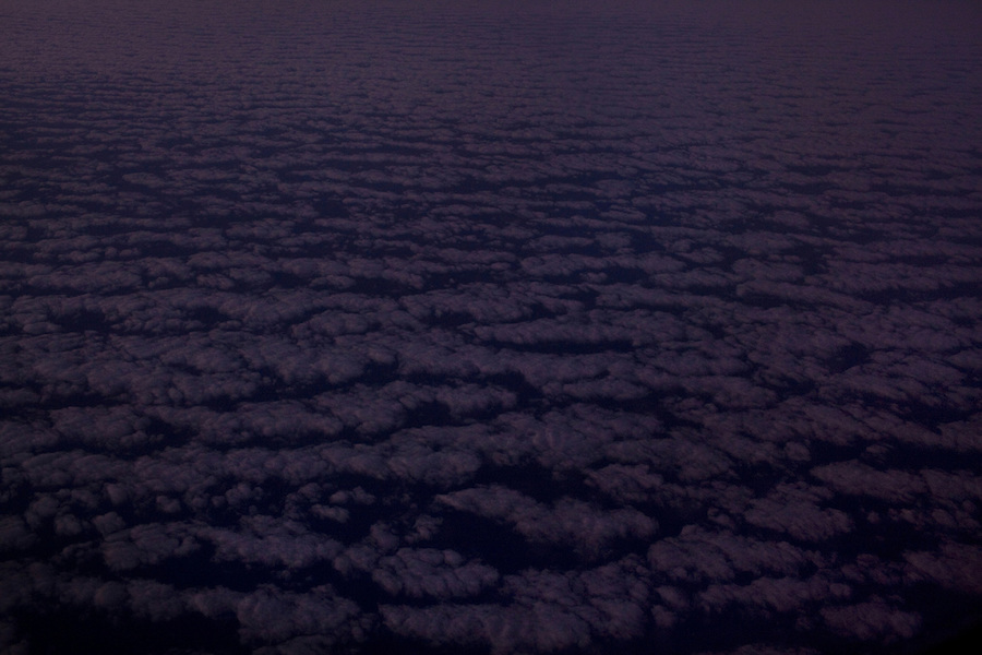 January 26, 2012 - A view of scattered clouds at dusk from an airplane over the Pacific Ocean en route from Kona, Hawaii to Los Angeles, California.