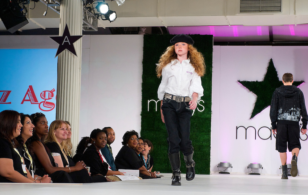 Model walking the runway for a back to school fashion show for Macy's.